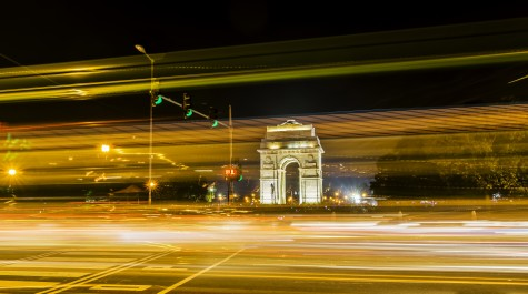 Light trails and India Gate in background