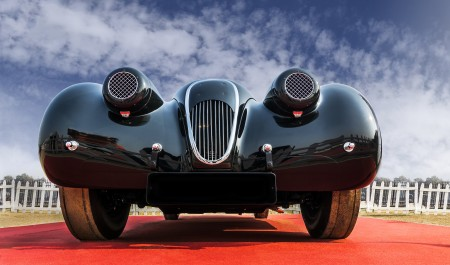 Front low angle view of a classic old-timer vintage sports car