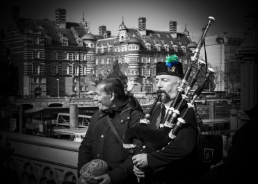 Bagpiper performs music on the Westminster bridge, London, United Kingdom